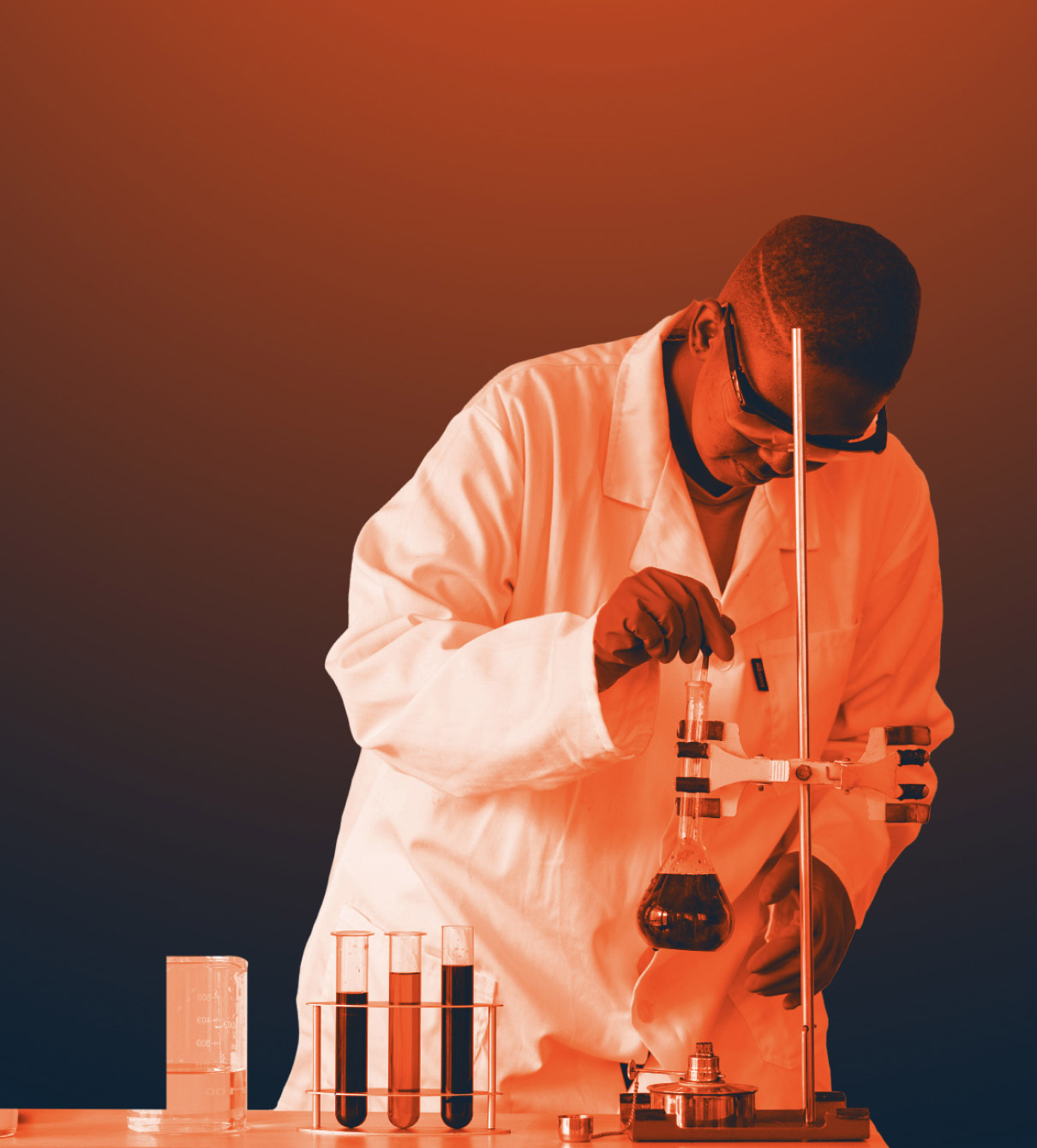 A black woman in lab coat and protective glasses using science and technological equipment.